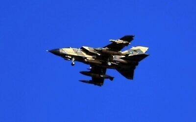 Illustrative: A Saudi tornado warplane flies over the Gulf Sea during a training mission, November 29, 2007. (Hassan AMMAR/AFP)