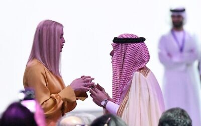 Ivanka Trump (left), senior White House adviser and daughter of the US president, speaks to an unidentified Emirati official during the Global Women Forum in the Gulf emirate of Dubai on February 16, 2020. (KARIM SAHIB / AFP)