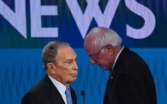 Democratic presidential hopefuls former New York Mayor Mike Bloomberg (L) and Vermont Senator Bernie Sanders (R) speak during a break in the ninth Democratic primary debate of the 2020 presidential campaign season in Las Vegas, Nevada, on February 19, 2020. (Mark Ralston/AFP)