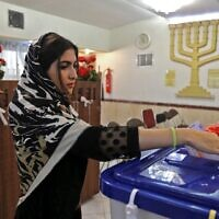 A Jewish Iranian woman casts her ballot at a polling station in the capital Tehran on February 21, 2020. (Atta Kenare/AFP)