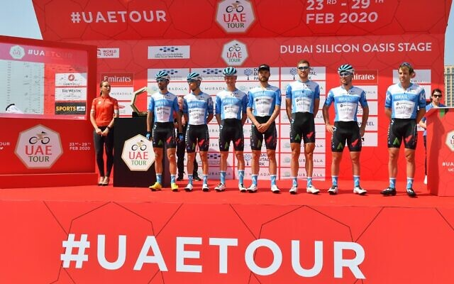 Israel Start-Up Nation cycling team members pose before the start of the first stage of the UAE Tour from the Pointe to Silicon Oasis in Dubai on February 23, 2020. (Photo by Giuseppe CACACE / AFP)