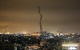 The smoke trail of a rocket, fired by Palestinian terrorists, flying over the Gaza Strip, on February 23, 2020. (Mahmud Hams/AFP)