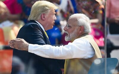 India's Prime Minister Narendra Modi (R) shakes hands with US President Donald Trump during 'Namaste Trump' rally at Sardar Patel Stadium in Motera, on the outskirts of Ahmedabad, on February 24, 2020. (Photo by Money SHARMA / AFP)