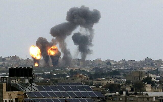 Fireballs and smoke rise into the air following an Israeli air strike in Khan Yunis in the southern Gaza Strip in response to rocket attacks by the Palestinian Islamic Jihad terror group throughout the day on February 24, 2020. (SAID KHATIB / AFP)