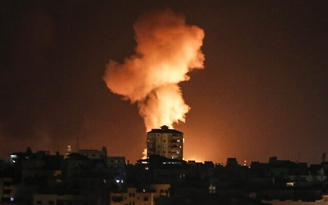 An explosion is seen following an Israeli airstrike on Gaza City in response to the firing of rockets by Palestinian terrorists in the coastal enclave toward Israel, February 24, 2020. (Mahmud Hams/AFP)