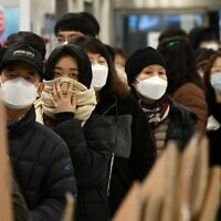 People wait in a line to buy face masks at a retail store in the southeastern city of Daegu on February 25, 2020. (Jung Yeon-je / AFP)