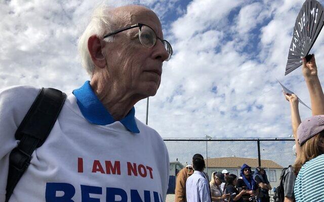 "Jeff Jones, 77, wearing his ""I am not Bernie Sanders"" sweater, attends a Bernie Sanders rally at a high school in Santa Ana, California, on February 21, 2020. (Javier Tovar/AFP)"