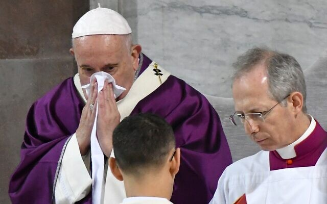 Pope Francis blows his nose as he leads the Ash Wednesday mass which opens Lent, the forty-day period of abstinence and deprivation for Christians before Holy Week and Easter, on February 26, 2020, at the Santa Sabina church in Rome. (Alberto PIZZOLI / AFP)