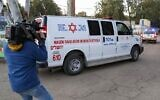 An ambulance carrying an Israeli man who was diagnosed with the coronavirus after returning from Japan arrives at Sheba Medical Center in Tel Hashomer on February 28, 2020. (Jack Guez/AFP)