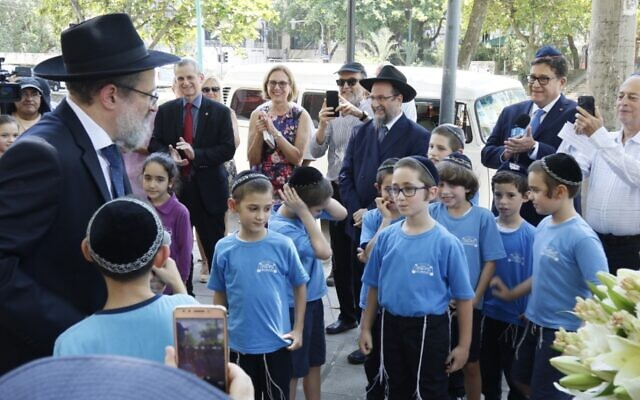 Members of the Chabad Hasidic community in Rio de Janeiro attend the naming of a square in the city's upscale Leblon neighborhood for the late Lubavitcher Rebbe, on February 19, 2020. (Courtesy Israeli honorary consulate in Rio)