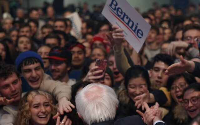 Democratic presidential candidate Sen. Bernie Sanders (I-VT) greets rally attendees after speaking at a campaign rally at the U.S. Bank Arena on February 1, 2020 in Cedar Rapids, Iowa. (Tom Brenner/Getty Images/AFP)