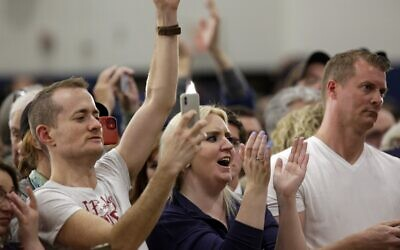 Attendees cheer as they listen to Democratic presidential candidate former vice president Joe Biden during a campaign event at Hiatt Middle School in Des Moines, Iowa, on February 2, 2020. (Joshua Lott/Getty Images/AFP)
