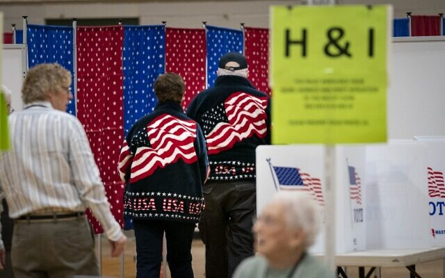 Voters walk to voting booths at a polling station at David R. Cawley Middle School on February 11, 2020 in Hookset, New Hampshire. (Drew Angerer/Getty Images/AFP)