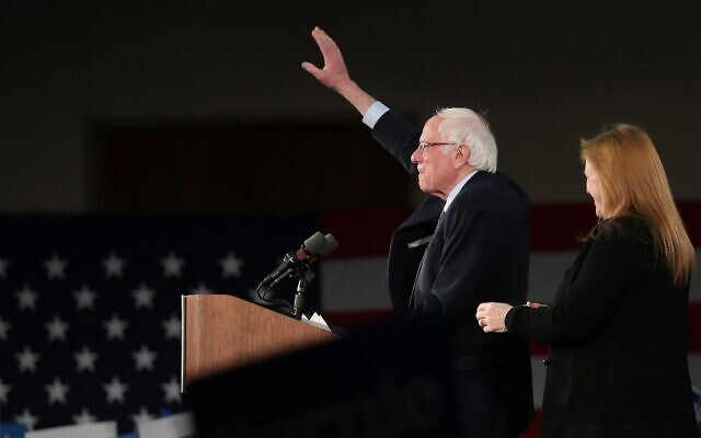 Democratic presidential candidate Sen. Bernie Sanders, with wife Jane Sanders (R), addresses supporters during his caucus night watch party on February 3, 2020, in Des Moines, Iowa (Joe Raedle/Getty Images/AFP)