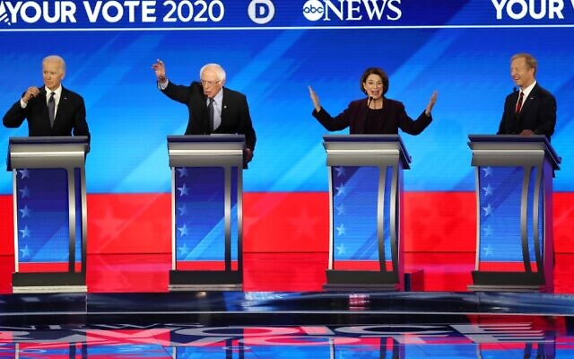 (L-R) Democratic presidential candidates former Vice President Joe Biden, Sen. Bernie Sanders, Sen. Amy Klobuchar and Tom Steyer participate in the Democratic presidential primary debate in the Sullivan Arena at St. Anselm College on February 07, 2020 in Manchester, New Hampshire (Joe Raedle/Getty Images/AFP)