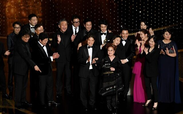 'Parasite' cast and crew including Cho Yeo-jeong, Park So-dam, Choi Woo-shik, Kang-Ho Song,Yang Jin-mo, Jin Won Han, Kwak Sin-ae, Ha-jun Lee, Yang-kwon Moon, Kang-ho Song, Yeo-jeong Jo, Bong Joon-ho, and Sun-kyun Lee accept the Best Picture award onstage during the 92nd Annual Academy Awards at Dolby Theatre on February 09, 2020 in Hollywood, California (Kevin Winter/Getty Images/AFP)