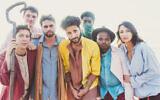Sammy Miller, center, in yellow, and his band the Congregation. (Lauren Desberg via JTA)