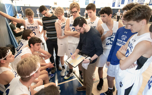 Coach Ben Falk provides instruction to his Barrack Hebrew Academy basketball team. (Jay Gorodetzer Photography/via JTA)