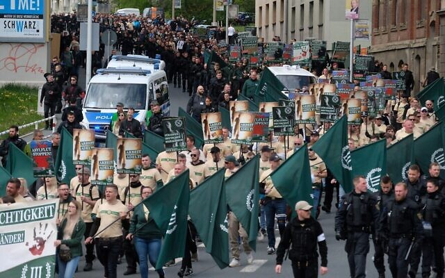 Far-right and neo-Nazi supporters walk through Plauen in eastern Germany, May 1, 2019. (Sebastian Willnow/DPA/AFP via Getty Images/ via JTA)