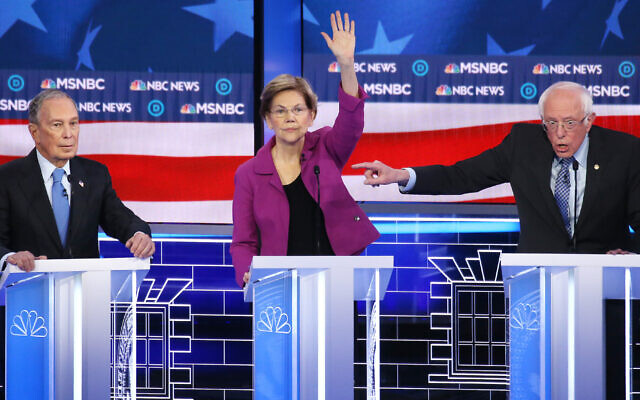 Democrat presidential candidate Mike Bloomberg, left, came under attack from Sen. Elizabeth Warren, Sen. Bernie Sanders and the other Democratic presidential candidates at the Nevada debate in Las Vegas, in Las Vegas, Nevada, February 19, 2020. (Mario Tama/Getty Images via JTA)