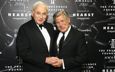 Leslie Wexner, left, and Ed Razek pose backstage at the 2016 Fragrance Foundation Awards presented by Hearst Magazines in New York, June 7, 2016. (Astrid Stawiarz/Getty Images for Fragrance Foundation/ via JTA)