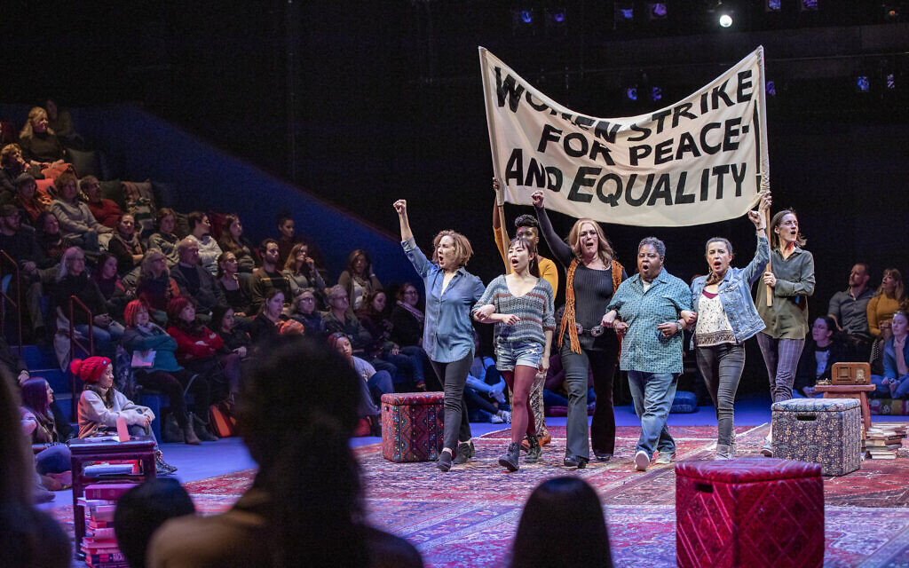 The cast of 'Gloria: A Life,' in a protest scene, by Emily Mann, directed by Diane Paulus, now at the American Repertory Theater in Cambridge, Massachusetts. (APrioriPhotography/ courtesy American Repertory Theater)