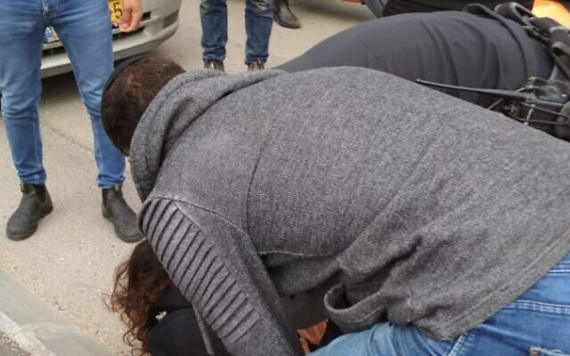 A suspect is arrested in a stabbing attack at Jerusalem's Armon Hanatziv promenade on February 21, 2020. (ZAKA)