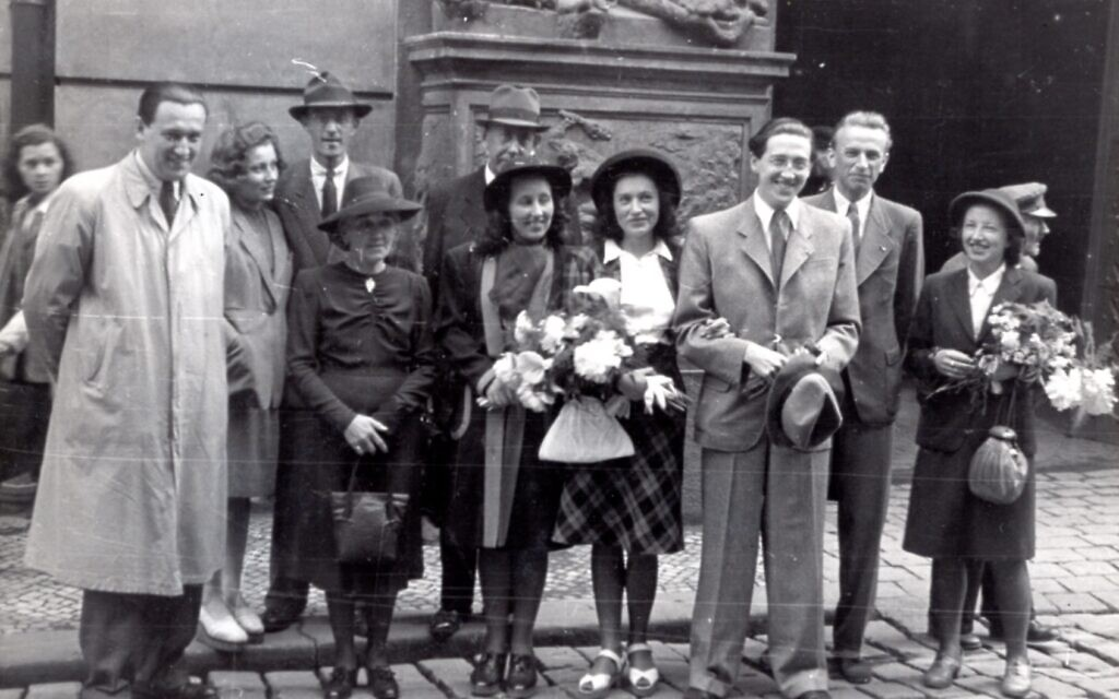 Wedding of Hans Neumann (third from right) to his first wife Mila (fourth from right) in Prague, June 2, 1945. At far left is Hans's brother Lotar, and is wife Zdenka is next to Mila. (Courtesy of Ariana Neumann)