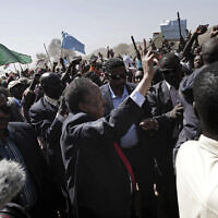 Sudanese Prime Minister Abdalla Hamdok, center, waves to people in the conflict-affected remote town of Kauda, Nuba Mountains, Sudan, January 9, 2020. (Nariman El-Mofty/AP)