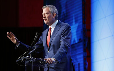 New York City Mayor Bill de Blasio speaks at the ​US Conference of Mayors' Winter Meeting, Wednesday, Jan. 22, 2020, in Washington. (AP Photo/Patrick Semansky)