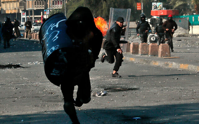 Security forces try to disperse anti-government protesters during clashes in Baghdad, Iraq, January 31, 2020. (AP Photo/Hadi Mizban)
