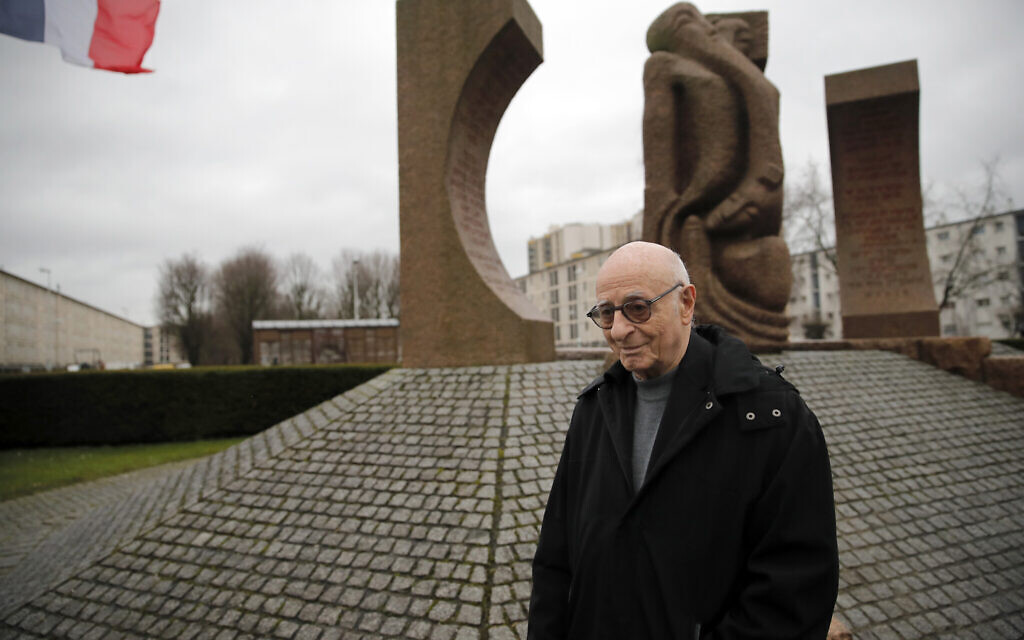 Victor Perahia, who was interned as a child in the Drancy camp and deported to Bergen-Belsen, speaks to students during a workshop dedicated to the Holocaust remembrance at the Drancy Shoah memorial, outside Paris, January 30, 2020 (AP Photo/Christophe Ena)