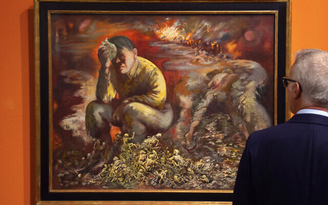 """A man looks at a 1944 painting """"Cain or Hitler in Hell,"""" by George Grosz, during a press preview at the German Historical Museum in Berlin, Germany, February 4, 2020. (AP Photo/Jens Meyer)"""