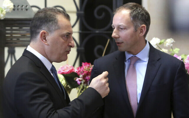 US Assistant Secretary of State Francis Fannon, right, and Cyprus' Energy minister Yiorgos Lakkotrypis talk during a meeting of Israeli, Cypriot and Greek experts working on boosting safety and security in offshore oil and gas drilling in Nicosia, Cyprus, February 5, 2020. (Petros Karadjias/AP)