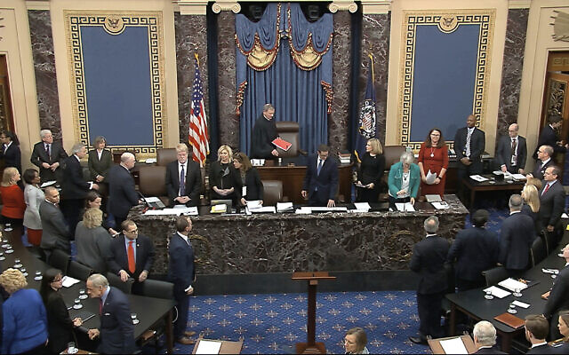 In this image from video, Chief Justice of the United States John Roberts arrives for the vote in the impeachment trial against President Donald Trump in the Senate at the US Capitol in Washington on February 5, 2020. (Senate Television via AP)