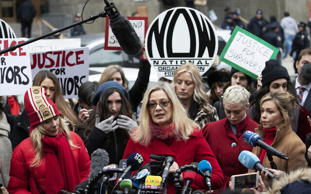 Louise Godbold, center, speaks at a news conference outside a Manhattan courthouse after Harvey Weinstein arrived in New York, January 6, 2020. (Mark Lennihan/AP)