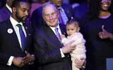 "Democratic presidential candidate and former New York City Mayor Michael Bloomberg is joined on stage by supporters during his campaign launch of ""Mike for Black America,"" at the Buffalo Soldiers National Museum, Thursday, Feb. 13, 2020, in Houston. (AP Photo/David J. Phillip)"