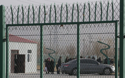 In this December 3, 2018, file photo, residents line up inside the Artux City Vocational Skills Education Training Service Center which has previously been revealed by leaked documents to be a forced indoctrination camp at the Kunshan Industrial Park in Artux in western China's Xinjiang region. (AP/Ng Han Guan, File)