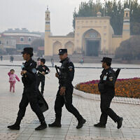 Uighur security personnel patrol near the Id Kah Mosque in Kashgar in western China's Xinjiang region, on November 4, 2017. (AP/Ng Han Guan, File)