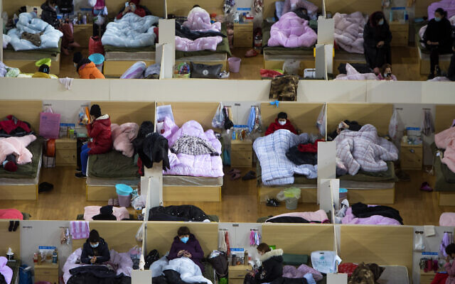 Patients infected with the coronavirus take rest at a temporary hospital converted from Wuhan Sports Center in Wuhan in central China's Hubei Province, February 17, 2020.  (Xiao Yijiu/Xinhua via AP)
