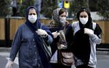 People wear masks to help guard against the Coronavirus on a street in downtown Tehran, Iran, February 23, 2020. (Ebrahim Noroozi/AP)