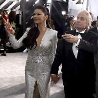 In this January 19, 2020 file photo, Catherine Zeta-Jones and Michael Douglas arrive at the 26th annual Screen Actors Guild Awards, in Los Angeles, California. (Photo by Matt Sayles/Invision/AP, File)