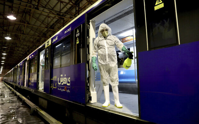 A worker disinfects subway trains against coronavirus in Tehran, Iran, in the early morning of February 26, 2020. (AP Photo/Ebrahim Noroozi)