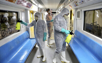 Workers disinfect subway trains against coronavirus in Tehran, Iran, in the early morning of February 26, 2020. (AP Photo/Ebrahim Noroozi)