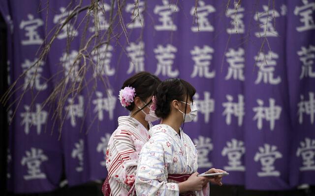 Visitors wear protective masks Wednesday, Feb. 26, 2020, in Tokyo, Japan. (AP Photo/Eugene Hoshiko)