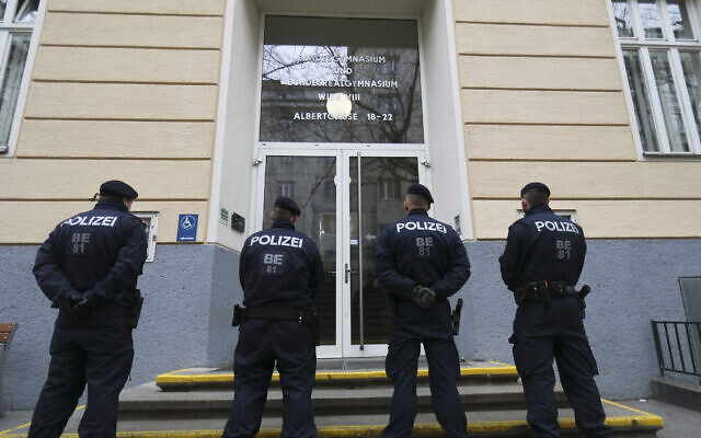 Police patrol in front of the High School Bundesgymnasium und Bundesrealgymnasium, BGRG 8, after the school was shut down by authorities after a teacher was suspected to be infected with the new coronavirus in Vienna, Austria, Wednesday, Feb. 26, 2020. (AP Photo/Roland Zak)