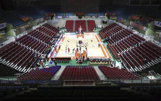 The stadium's seats are empty during the Korean Basketball League between Incheon Electroland Elephants and Anyang KGC clubs in Incheon, South Korea, Wednesday, Feb. 26, 2020. (Yun Tai-hyun/Yonhap via AP)