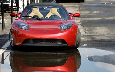 The Tesla Roadster electric car sits parked on a street in New York, Thursday, Feb. 19, 2009 (AP Photo/Craig Ruttle)