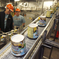 Ice cream moves along the production line at Ben & Jerry's Homemade Ice Cream, in Waterbury, Vermont. on March 23, 2010. (AP Photo/Toby Talbot/File)