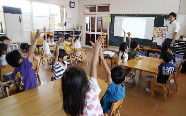 Illustrative -- Japanese schoolchildren at a Coby Preschool in Yoshikawa, suburban Tokyo, July 12, 2018. (AP Photo/Yuri Kageyama)